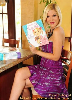 Tori Spelling Holding Her New Book, Presenting... Tallulah