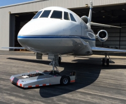 A Towbarless Remote Controlled Electric Aircraft Tug System Capable of Towing Very Large Business Jets in Challenging Conditions