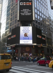 Lynette Monzo Presented on the Reuters Billboard in Times Square in New York City by Strathmore's Who's Who Worldwide Publication