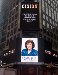 Gloria B. Gertzman, Ph.D., D.M.D., F.A.G.D., C.C.H.P. Honored on the Reuters Billboard in Time Square in New York City by P.O.W.E.R.