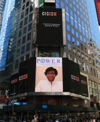 Michele Briscoe Honored as a Woman of the Month and on the Reuters Billboard in Times Square by P.O.W.E.R. (Professional Organization of Women of Excellence Recognized)