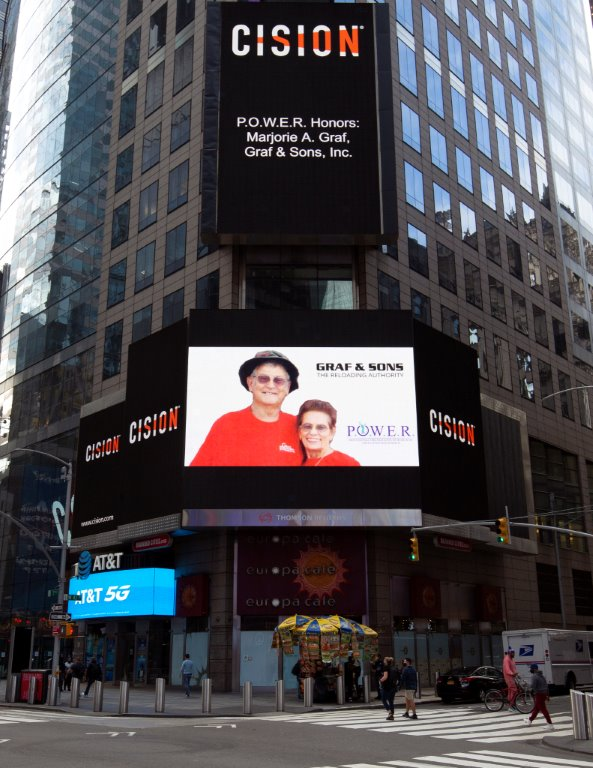 Marjorie A. Graf of Graf & Sons, Inc. Showcased on the Reuters Billboard in Times Square in New York City by P.O.W.E.R.