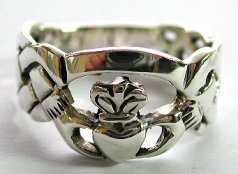 Claddagh sterling silver ring with hand-holding-heart decor in middle and knot work onsides