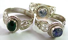 Designer jewelry silver sterling ring with assorted semipresicious gemstones and filigree cutout
