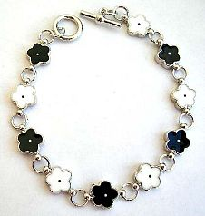 Multi enamel black and white flower pattern forming fashion bracelet, with toggle jewelry clasp for
