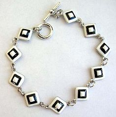 Multi enamel black and white diamond pattern forming fashion bracelet, with toggle jewelry clasp for