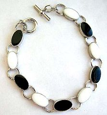 Fashion bracelet with toggle jewelry clasp for convenience closure in multi enamel black and white e
