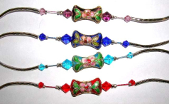 Fashion bracelet with curved long strip and diamond shape color beads inlay holding a fan shape hand