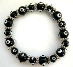 Multi black hand-painted lampwork glass beads ( mystical eye handmade beads ) and flat silver beads