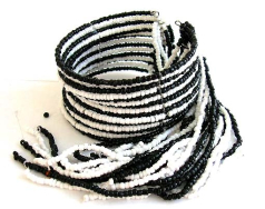 Multi black and white beaded strings forming fashion bracelet bangle with multi beaded string dangle