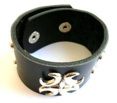 Fashion bracelet in black wide imitation leather band design with multi rounded shiny beads decor al