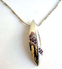 Fashion necklace with beaded chain holding a multi mini purple cz embedded long olive shape metal pe