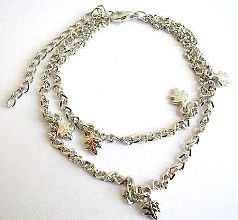 Fashion anklet in double twisted chain design with multi leaf pattern decor