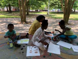 Art in the Park participants painting in  the gazebo at Howell Park