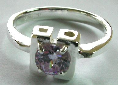 Open-square pattern central design sterling silver ring with rounded light purple cz embedded in mid