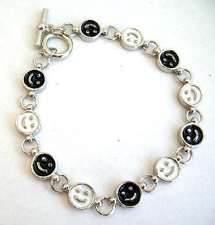 Multi enamel black and white happy face pattern forming fashion bracelet, with toggle jewelry clasp