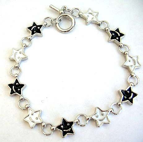 Fashion bracelet in multi enamel black and white star face pattern design, with toggle jewelry clasp