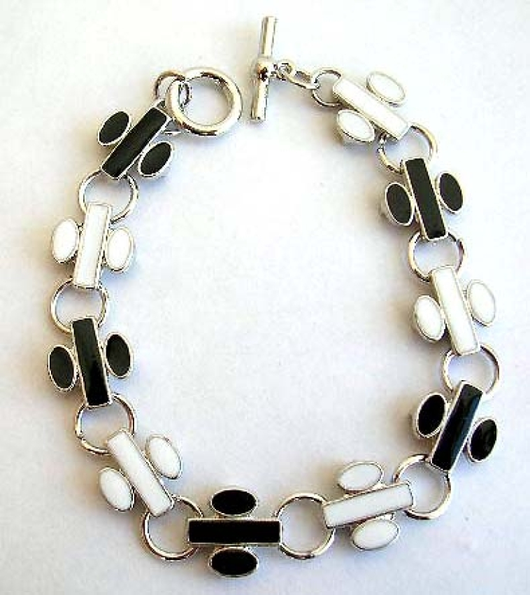 Fashion bracelet in multi enamel black and white flying jet pattern design, with toggle jewelry clas