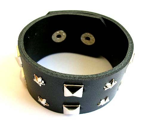 Fashion bracelet in black wide imitation leather band design with multi faceted square and mini star
